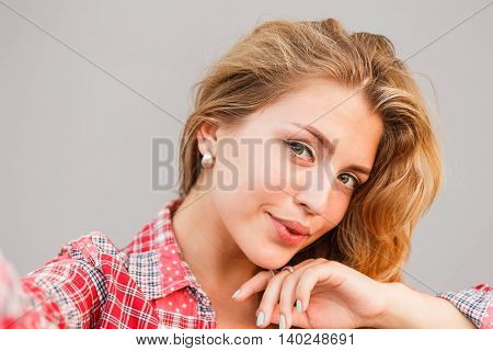 Young beautiful blonde woman photographed themselves on mobile phone