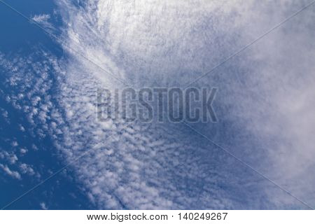 Natural blue sky with Cirrus radiatus, cirrocumulus clouds formation