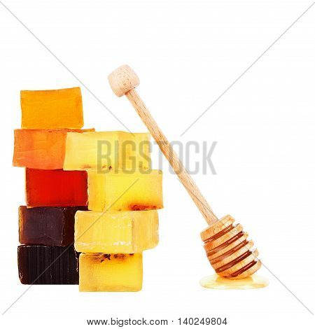 Set glycerol honey handmade soap with a spoon for honey and honey drops isolated
