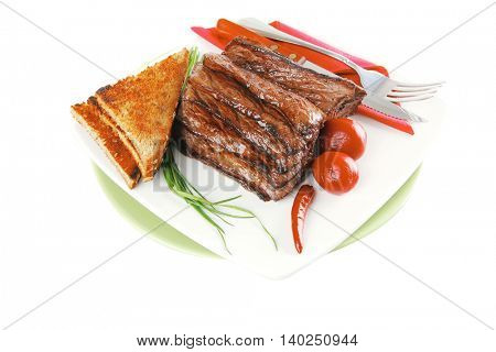 roast beef meat with dishware over white