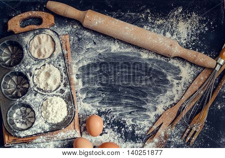 Baking pastry ingredients. Cooking course poster background - layout with free text space. Baking concept with variety of baking utensils with different kind of flour and eggs. Top view. Copy space.