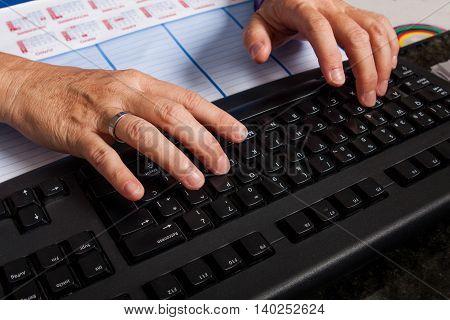 clerk keyboarding on computers keyboard in office