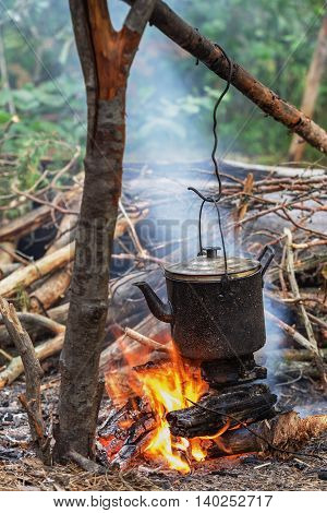 Old Iron Kettle On Fire. Cooking Food In Field Conditions