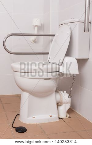 toilet with supporters for people with disabilities