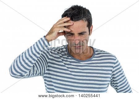 Stressed mid adult man standing against white background