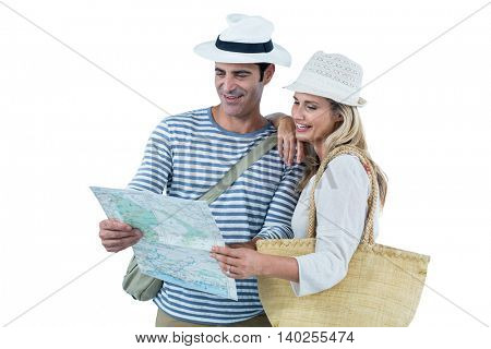 Mid adult couple reading map against white background