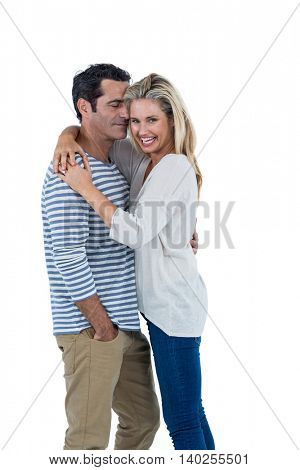 Happy mid adult romantic couple hugging against white background
