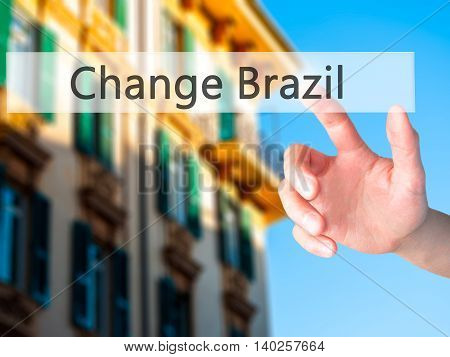 Change Brazil - Hand Pressing A Button On Blurred Background Concept On Visual Screen.