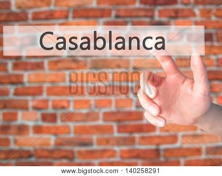 Casablanca - Hand Pressing A Button On Blurred Background Concept On Visual Screen.