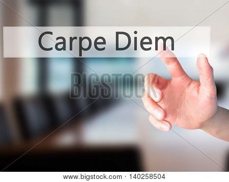Carpe Diem - Hand Pressing A Button On Blurred Background Concept On Visual Screen.