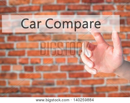 Car Compare - Hand Pressing A Button On Blurred Background Concept On Visual Screen.