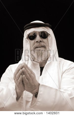 The Chic Sheik Wears Sunglasses