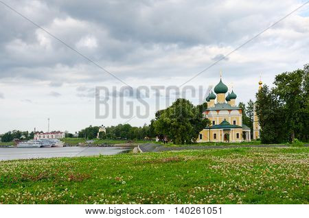 View of Transfiguration of Savior Cathedral and river pier on cloudy day Uglich Golden Ring of Russia