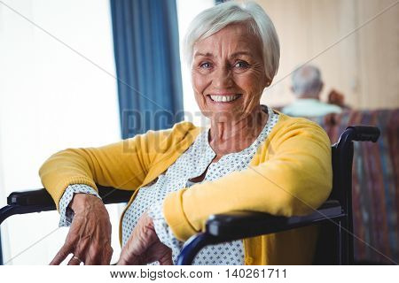 Smiling senior woman on a wheelchair looking at camera