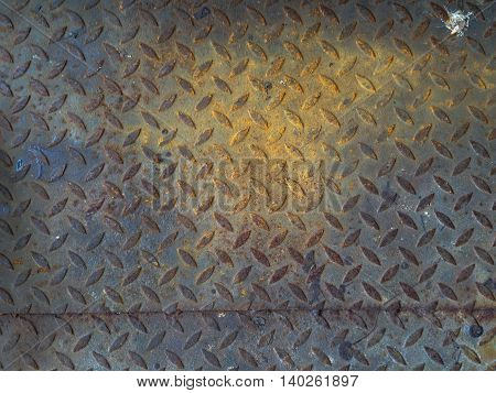 The damage metal diamond plate background texture
