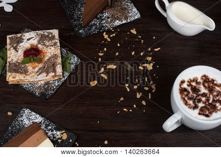 Table with cakes ans coffee cup