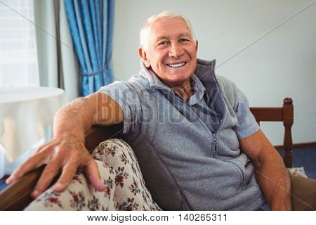 Senior man sitting on a couch in a retirement home