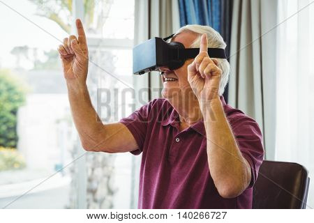 Senior man using a virtual reality device in a retirement home