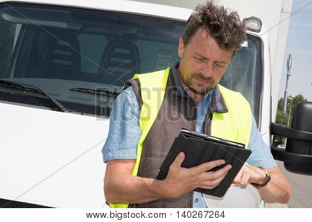 Delivery : Man Checking Portable Delivery Device