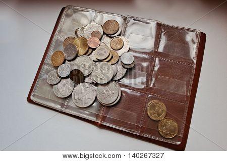Different vintage countries coins at umismatics album