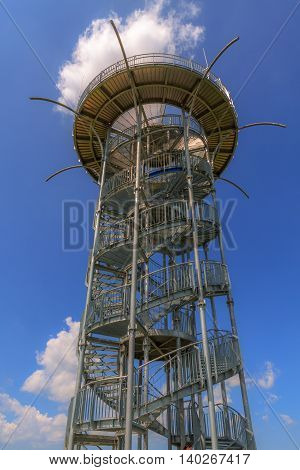 Metal observation tower with a spiral staircase.