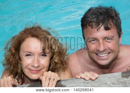 Happy And Lovely Couple In Private Swimming Pool