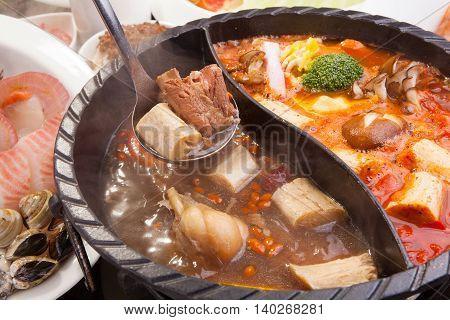 Hot pot of pork seafood and mushroom in restaurant