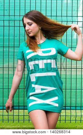 Model posing near the lattice. Summer shoot