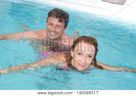 Middle Aged Couple Having Fun In The Water