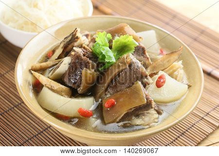 Mixed soup of beef and radish on chinese bowl on bamboo tray