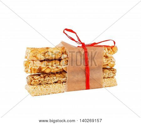 Set of traditional eastern sweets kozinaki made of nuts isolated on white