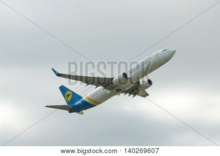 Borispol Ukraine - October 2 2011: Ukraine International Airlines Boeing 737-800 is taking off into cloudy sky