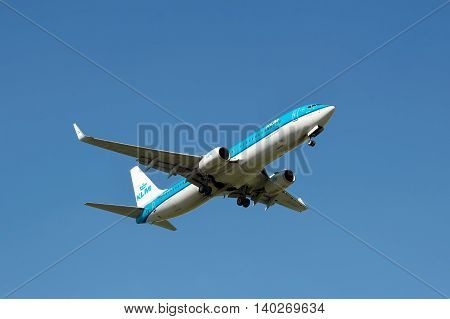 Borispol Ukraine - June 9 2011: KLM Boeing 737 is landing against blue sky in summer
