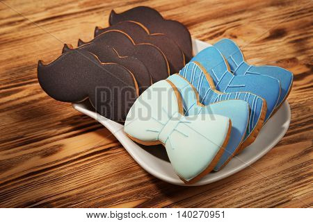 Happy Father's Day concept. Tasty cookies on plate on wooden background