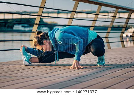 Woman streching after training outdoors, toned image, horizontal image