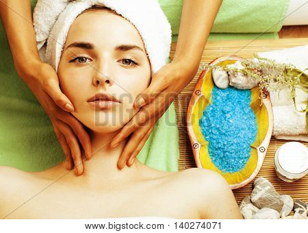 stock photo attractive lady getting spa treatment in salon, close up asian hands on face, lifestyle people concept
