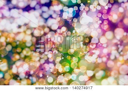 Festive Background With Natural Bokeh And Bright Golden Lights. Vintage Magic Background With Color Festive background with natural bokeh and bright golden lights. Vintage Magic background with colorful bokeh. Spring Summer Christmas New Year disco party