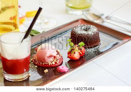 Triple dessert with chocolate and strawberry on wedding table set
