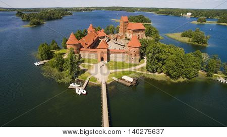 AERIAL. Beautiful old castle in Trakai from the sky summer day shot