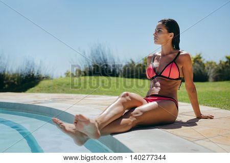Attractive Young Woman Relaxing At Poolside