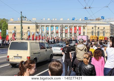 St. Petersburg, Russia - 9 May, People and vehicles on the Palace bridge, 9 May, 2016. Celebration day of victory in the center of St. Petersburg.