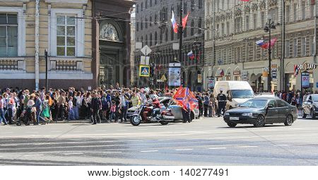 St. Petersburg, Russia - 9 May, A crowd of people on the street, 9 May, 2016. Celebration day of victory in the center of St. Petersburg.
