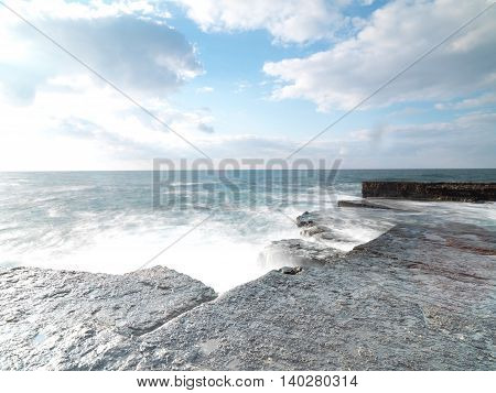 longexposure shhot to sea side with rocks and sea waves