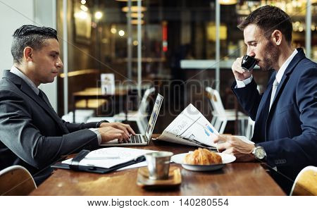 Businessmen Cafe Newspaper Laptop Concept