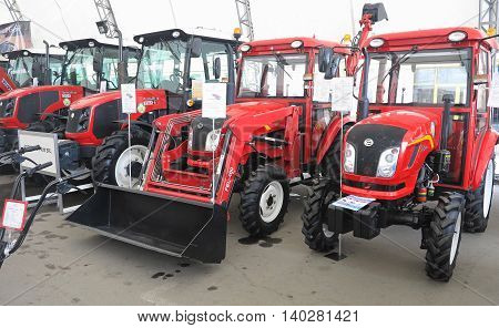 Moldova Chisinau 05 march 2016: New red powerfull tractors at exhibition of agricultural machinery