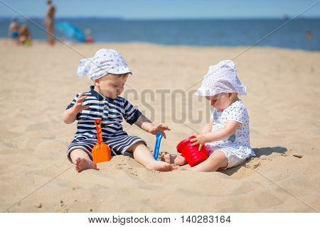 Twins playing at the beach of Baltic Sea, Poland