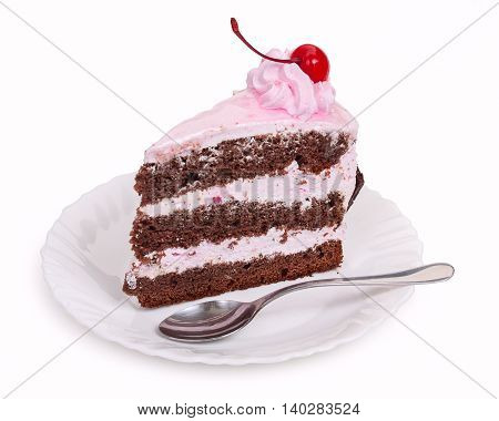 A delicious piece of chocolate cake with cherry cream and canned cherries on a white plate with a teaspoon close-up.