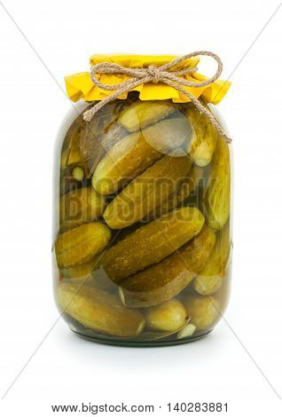 Homemade Pickled Cucumbers In Glass Jar With Yellow Paper Wrapper. Jar Of Canned Cucumbers Isolated