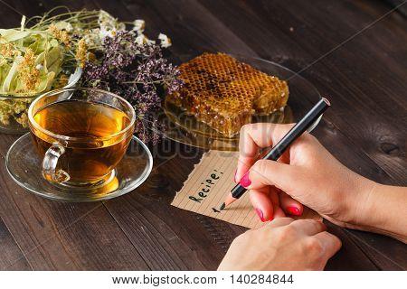 Teapot With Herbal Tea On Kitchen Table