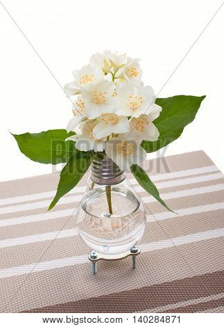 Handmade Light Bulb Vase With Jasmine Flowers On Decorative Napkin On A White Background.